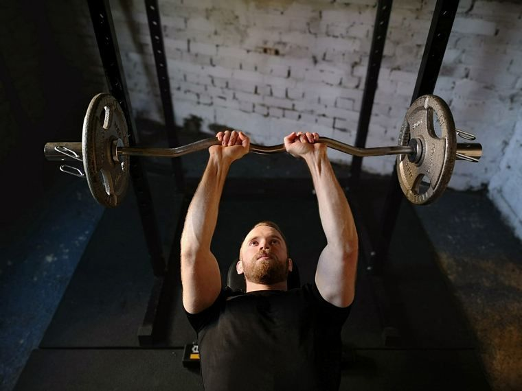 man training with weights