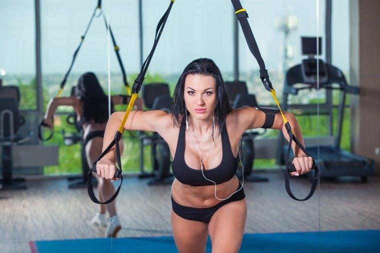 woman does crossfit push ups